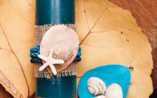 Velas con decoraciones marinas, con las gamas de colores de mar y la arena. Creadora: Evelyn Madrigal.