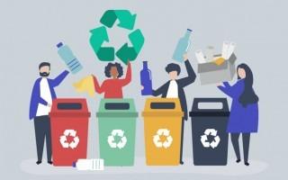Imagen de varias personas depositando desechos en la batería de reciclaje.