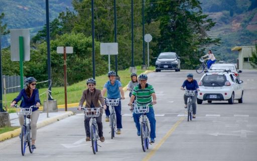 Image of several people riding a bicycle inside the TEC Campus
