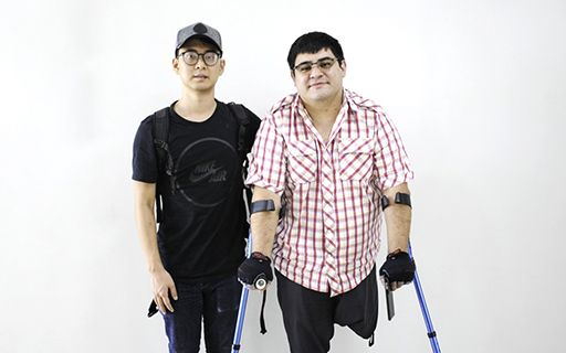 Two young people with disabilities, one of them without a leg.