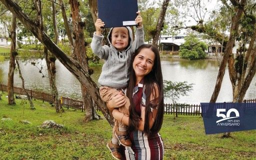 Fiorella González and her son Gabriel, showing the title of Engineer.