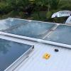 Sistema de colectores solares para el calentamiento de agua instalados en el techo del sistema solar activo híbrido forzado instalado en la Fábrica Artesanal Chocolates Fusión.