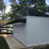 Cámara de secado, tuberías de aire caliente y colectores térmicos del sistema térmico solar activo forzado híbrido instalado en Katira (Guatuso) para la Asociación de Productores Agroecológicos de Cacao.